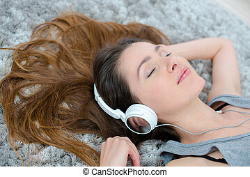 Lady listening to headphones