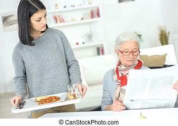 Carer serving a senior lady
