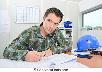 Construction worker at desk