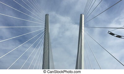 Trip across large, cable stayed bridge on  machine.