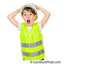 workwear boy - Cute boy in a costume of a builder posing...