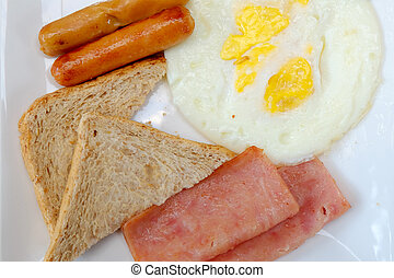 breakfast with fried eggs, bacon, sausages