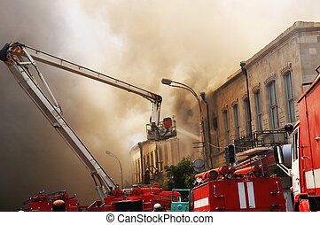 Firefighters at the fire in the citycenter - Firefighters at...