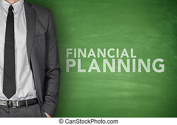 Financial planning text on green blackboard with businessman