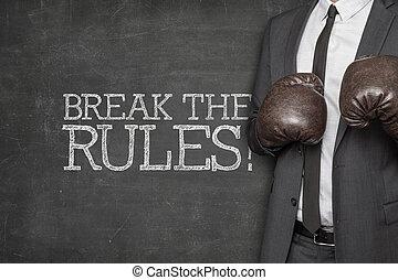Break the rules on blackboard with businessman wearing...