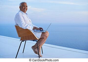 senior man working on laptop computer
