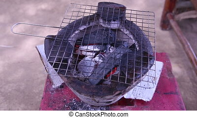 charcoal grill on vietnam stove ready for cooking