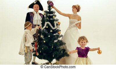 Aristocrats Dress Up The Tree - A young family of...