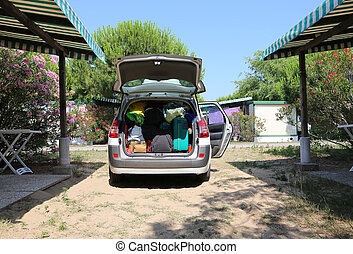 luggage and suitcases in car for departure for family...