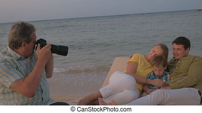 Taking Photos from Vacation - Steadicam shot of mature...