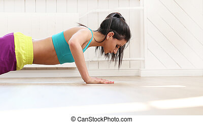 Girl in the gym - Sport. Beautiful girl in the gym