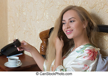 Sexy Young Girl Wearing White Nightdress Combing her Hair...