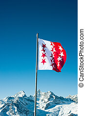 Flag of canton Wallis, Switzerland with snow mountains in...