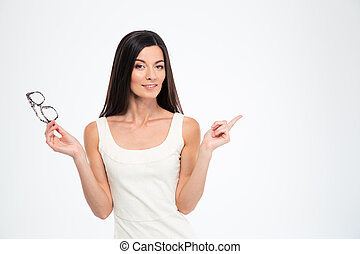 Woman holding glasses and pointing finger away - Hapyp woman...