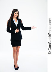 Smiling businesswoman showing welcome gesture - Full length...