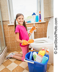 smiling girl cleaning toilet with brush - Cute smiling girl...