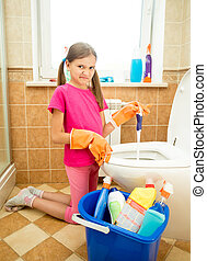 girl cleaning toilet with disgust - Cute girl cleaning...