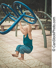 Baby doing exercises on a playground
