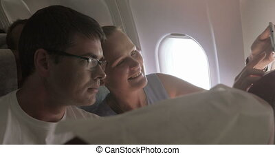 Couple Taking Selfie in the Plane - Young couple is taking...