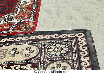ancient carpets on sandy beach in Egypt - two ancient...