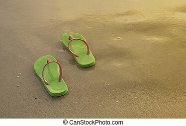 Flipflops - Summer vacation concept--Flipflops on a sandy...