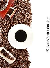 Cup of coffee with saucer and mill background - Coffee cup...