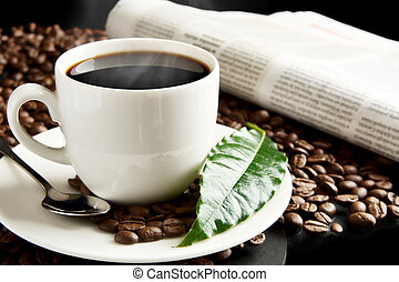 Cup of coffee with haze with newspaper,coffee leaf at...