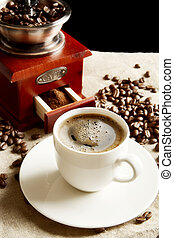 Cup of coffee with bag,coffee beans on flax linen - Cup of...