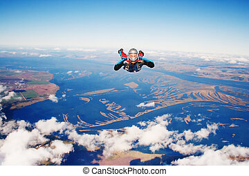 Skydiver in the. Parachuting is fun!