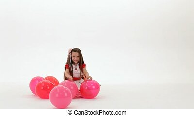 Girl Playing With Balloons - Little girls play with balloons...