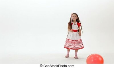 Cheerful Girl - A girl playing in the studio on a white...