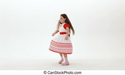 Girl On A White Background - The little girl turns to a...