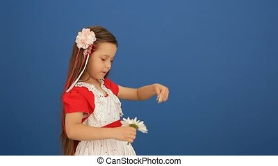 Girl And Flower - Charming little girl in a beautiful dress...