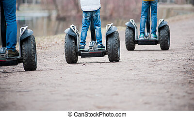 Segway - People riding segway - personal self-balancing...