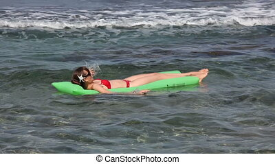 swimming on an air mattress - woman wimming on an air...