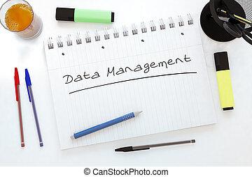 Data Management - handwritten text in a notebook on a desk -...