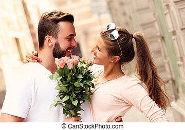 Happy romantic couple with flowers