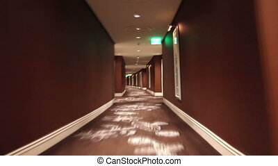 Hallway Loop - Looping shot, moving quickly through a long...