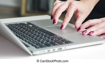 Woman use touchpad on a laptop - Girl types and search...