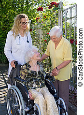 Doctor and Assistant Caring Elderly at the Garden