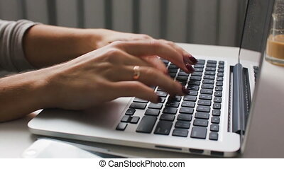 Work with a laptop typeing on a keyboard - Girl types and...