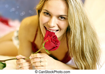 pretty young woman with rose