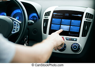 hand pushing button on car control panel screen - transport,...