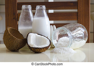 Coconut products. Cracked open coconut with meat cut in...
