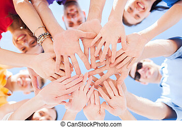 many hands over blue sky background - togetherness, team,...