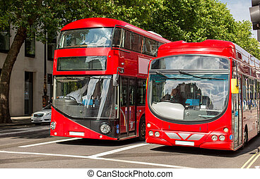 city street with red double decker buses in london - city...