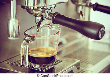 Prepares espresso in coffee shop ( Filtered image processed...
