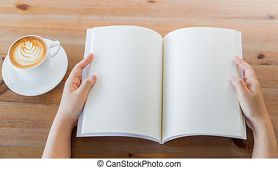 Hands open Blank catalog, magazines,book mock up on wood...