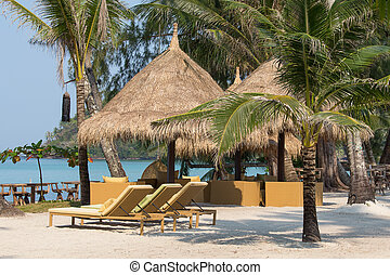 Beach chairs in a tropical beach, Thailand - Beach chairs in...