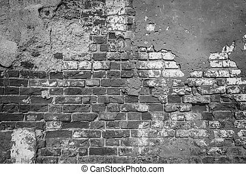 Monochrome image of the ancient brick wall.